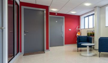 Inside an office with red walls.