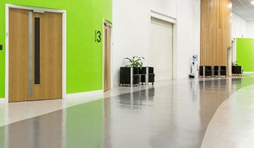 An empty hallway with green walls