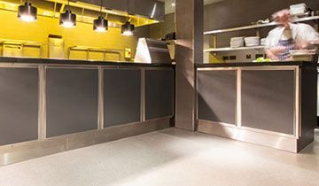 Inside a kitchen with silver and yellow decor.