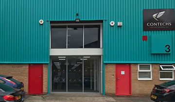picture of the outside of a warehouse unti recently painted