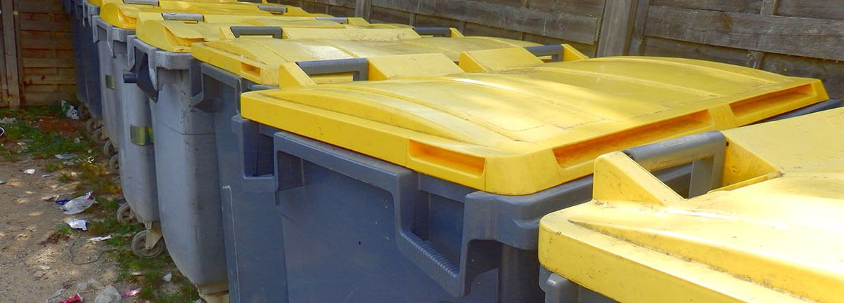 Row of bins with yellow lids